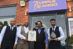 Purple Mango manager Gaz Uddin (centre left) with his staff after winning the Banbury Guardian's Restaurant of the Year 2018 competition NNL-180509-092942001
