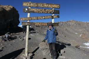 Richard Valdambrini reaches the summit of Mt Kilimanjaro. He is raising money for The David Sheldrick Wildlife Trust who rehabilitate orphaned elephants NNL-180110-120101001