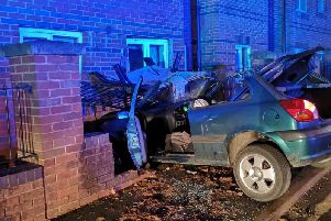 The wreckage of the car which crashed into the wall on Britannia Road, Banbury. Photo: Oxfordshire Fire and Rescue Service