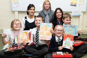 Bloor Homes Sales Manager Emma Bromham (left) and Sales Advisor Beverley James-Hill (right) with William Morris Primary School Assistant Head Teacher Claire Martin (centre) and pupils, from left, Poppy, Tyler, Layla and Aidan NNL-181221-143747001