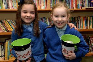 Honour Nolan, left, and Alannah Butler-McLees, from Holy Trinity Catholic School, Chipping Norton, raised money for Shelter NNL-190115-150659009