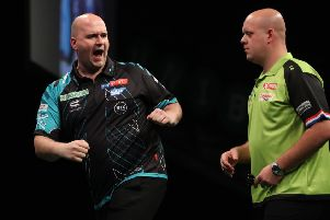 Rob Cross celebrates during his semi-final match against Michael van Gerwen at the 2018 Unibet Premier League Play-Offs. Picture courtesy Lawrence Lustig/PDC