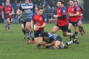 Banbury Bulls' Duncan Leese is tackled at Newbury Blues. Photo: Simon Grieve