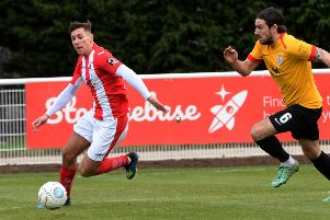 Brackley Town's Matt Lowe leaves  Bradford Park Avenue's Luca Havern behind. Photo: Jake McNulty
