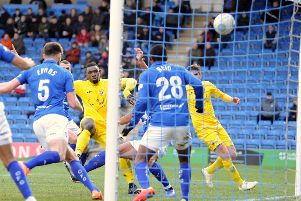 Top scorer Lee Ndlovu puts Brackley Town ahead at Chesterfield. Photo: Anne Shelley