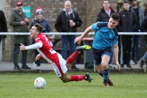 Brackley Town's Matt Lowe is fouled by AFC Telford's Ross White at St James Park. Photo: Steve Prouse