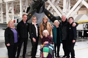 Violet Mitchell (centre) with Ruth Langsford, Eamonn Holmes, her sister, the team from Highmarket House and the museum