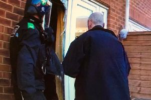 Police raid a property in Padbury Drive, Banbury. Photo: Thames Valley Police/Twitter