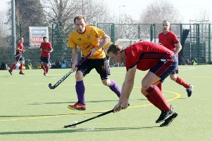 Banbury's Jonny Stirrup retains possession against Winchester. Photo: Steve Prouse