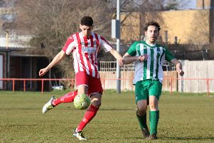 Easington Sports striker George Coombes gets his shot away against Almondsbury as Daniel Lane looks on. Photo: Steve Prouse