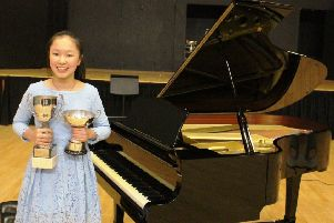Banbury Young Junior Musician of the Year 2018  Amelie Chen with trophies NNL-181202-133609001