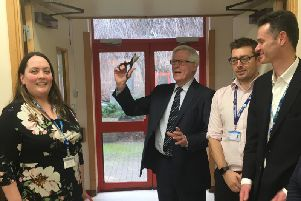 John Craven cuts the ribbon at the Horton General Hospital's new integrated services hub with (L-R) Kathy Hall, director of strategy, head of therapies Terry Cordrey and director of improvement John Drew