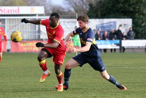 Banbury United's Greg Kaziboni takes on Needham Market's Callum Sturgess. Photo: Steve Prouse
