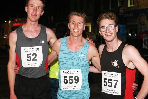 Winner Jonathan White (centre) with runner-up Jack Woods (left) and third-placed Ethan Fincham / Picture by Derek Martin