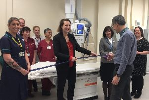 Oxford University Hospitals NHS Foundation Trust chief executive Bruno Holthof cuts the ribbon with (L-R) radiology staff, Victoria Prentis MP, Oxfordshire Clinical Commissioning Group chief executive Lou Patten, and trust director of strategy Kathy Hall. Photo: OUH