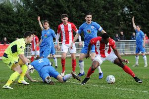 Brackley Town's Lee Ndlovu is thwarted against Stockport County. Photo: Jake McNulty