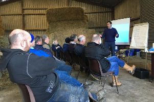 Cormac McKervey, Ulster Bank discussing investment with a Co Down Business Development Group on John Coulter's farm Dromara