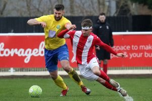 Brackley Town Saints' George Ball beats Ascot United's Chris Ellis at St James Park. Photo: Steve Prouse