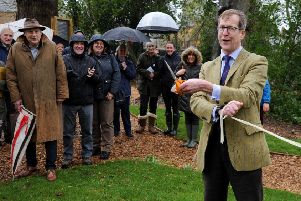 Swalcliffe Community Woodland Play Park opening. Neil Urquhart, chaiman of Swalcliffe Parish Council, cuts the ribbon. NNL-191203-144939009