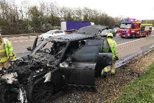 The charred remains of the car which caught fire on the M40 near Banbury. Photo: Thames Valley Police