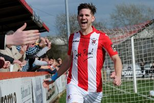 Brackley Town's James Armson celebrates after giving his side the lead against Kidderminster Harriers. Photo: Jake McNulty