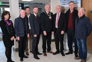 Chair of Mid Ulster District Council, Councillor Sean McPeake is pictured at St Patricks Hall Ardboe with representatives from the Council, DAERA and the Ardboe Parish Centre following the completion of 234K village renewal works.