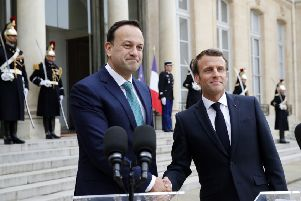French President Emmanuel Macron, right, shakes hands with Irish Prime Minister Leo Varadkar in Paris yesterday