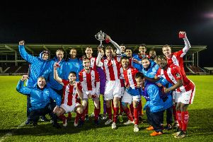 Brackley Town players and staff celebrate their NFA Hillier Cup success at Sixfields