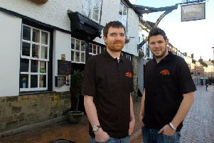 Anthony Murrary (left) and Jem Morey outside Ye Olde Reindeer Inn after taking over in 2013