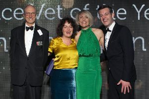 Vet of the Year winner Hannah Capon from Canine Arthritis Management with awards hosts Chris Laurence and Matt Baker, and Adele Waters from sponsor Vet Record