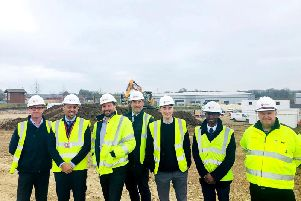 Kingsley Healthcare Group chief investment officer Muj Malik, second left, and investment analyst Leslie Amanquah, second right, with the care home developers on site in Brackley. Photo: Kingsley Healthcare Group