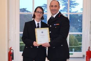 Michelle Peacock receives her award from chief fire officer Simon Furlong. Photo: Oxfordshire County Council NNL-190418-143113001