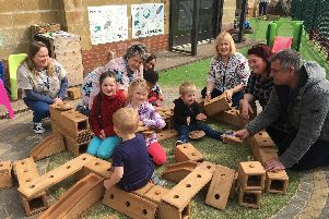 Children and adults play with the blocks at The Sunshine Centre's Easter fun day, won through Oxfordshire County Council