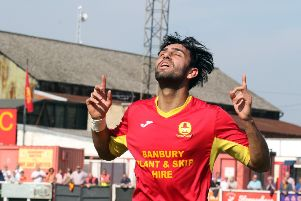 Ravi Shamsi celebrates after equalising for Banbury United against Bedworth United. Photo: Steve Prouse