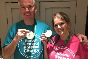 Tom and Millie Purton with their Paris Marathon medals. Photo courtesy of Horton General Hospital Charity NNL-190424-101704001