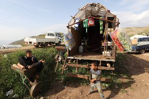 Syrian children in a makeshift camp in the Hama province not far from Turkish troops. Photo: Getty Images
