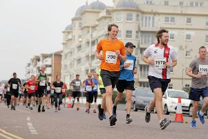 The 10k runners hit the seafront / Picture by Neil Cooper