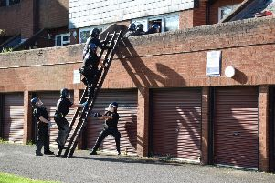 A Banbury warrant is carried out in Jubilee Court as part of Operation Stronghold NNL-190520-162005001