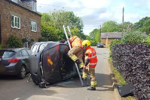 Firefighters at the scene of the crash in Edgehill. Photo: Warwickshire Fire and Rescue Service