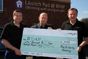 Fine and Country Estate Agents present a cheque to BYHP, Banbury. Terry Robinson, left and Chris Mobbs, right, Fine and Country, with Patrick Vercoe, BYHP CEO, in the middle. NNL-190521-131341009
