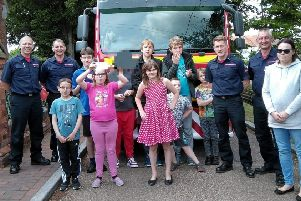The Rainbow Flyers group with the crew of Sleaford Fire Station. Image supplied.