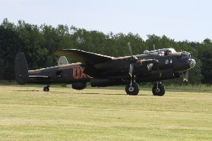 A Lancaster bomber on a taxi run - share your wartime memories with the IBCC. EMN-190716-175250001