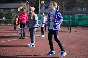 Youngsters enjoying tennis.