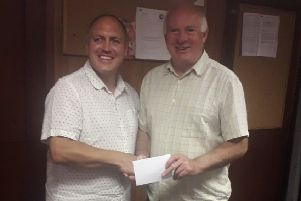 Richard Auciello (left), of Voluntary Action Rutland, with Melton Charity Cup chairman Gordon Wells EMN-190731-113243002
