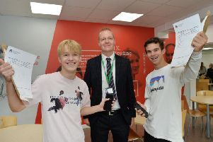 Form teacher Mark Payne with Elliott Sneath and James Skipworth as they celebrate their GCSE results at Robert Smyth Academy. PICTURE: ANDREW CARPENTER