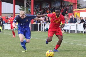 Banbury United's Gedeon Okito takes on Gainsborough Trinity's Simon Russell during Saturday's Emirates FA Cup tie. Photo: Steve Prouse