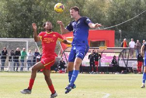 Banbury United's two-goal hero Janaai Gordon challenges Gainsborough Trinity's Nathan Hutte during Saturday's Emirates FA Cup tie. Photo: Steve Prouse