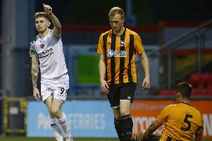 Jamie McGonigle celebrates one of his goals during the County Antrim Shield game at Seaview.'Picture By: Arthur Allison/Pacemaker Press