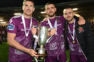 Dundalk trio Patrick McEleney, Dean Jarvis and Michael Duffy celebrate winning the EA Sports Cup and could joint the list of Derry men to win a domestic treble.