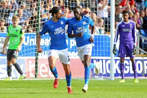 Mo Eisa (right) and George Boyd celebrate the second Posh goal. Photo: Joe Dent/theposh.com.